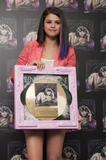 th 63257 SelenaGomezacceptsagoldrecordforheralbumWhenTheSunG 0007 123 120lo Selena Gomez   Receives gold record for When The Sun Goes Down, Four Seasons Hotel, Jan. 26, 2012